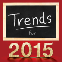 Trends for 2015 on blackboard in red background
