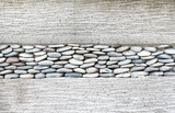 Fototapety Wall layer with pebbles stone and cement,Texture background