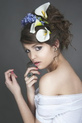 Beautiful female model with flowers in her hair