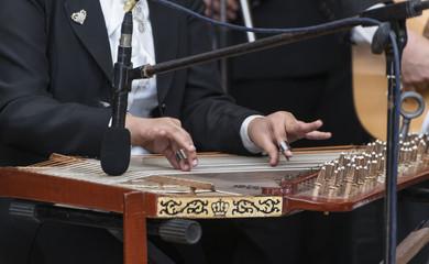 Hands and Arabian Qanon Musical Instrument