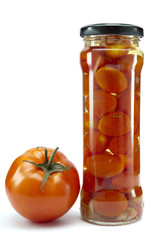 canned tomatoes in glass jars