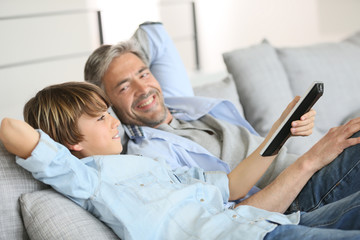 Father and son watching tv together