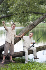 The father with the son on fishing, shows the size of fish..