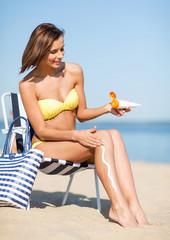 girl sunbathing on the beach chair