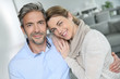 Portrait of mature couple relaxing at home - 81177510
