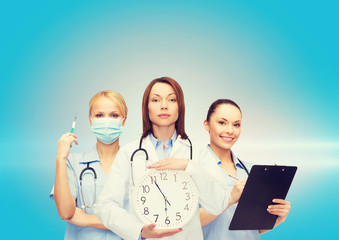 calm female doctor and nurses with wall clock
