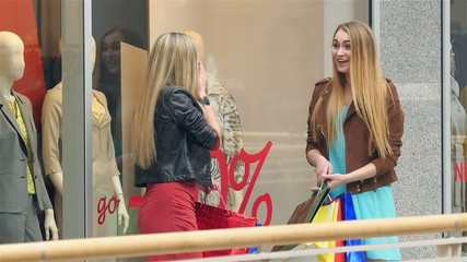 Two blondes on shopping discuss something very emotional about