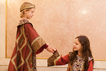 boy giving girl hand during theater play