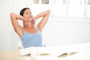 Cheerful adult woman sitting and looking relaxed