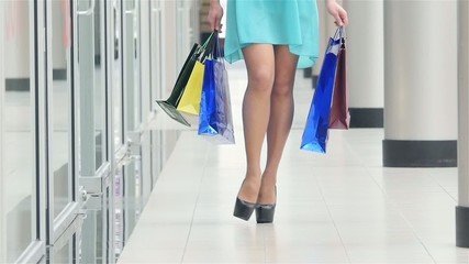 Beautiful female legs go around the store, close up, Slow motion