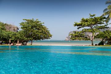 swimming pool at thailand touristic resort beach