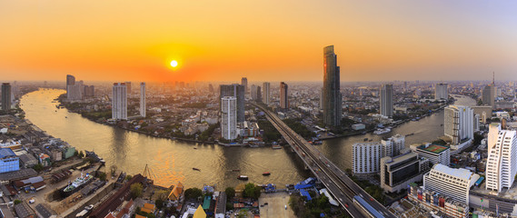 River in Bangkok city with high office building at sunset