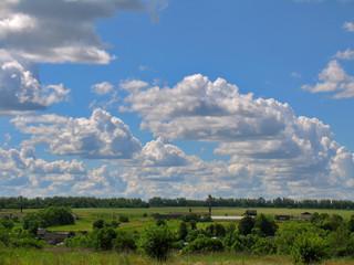 Cloud cascade against the blue sky