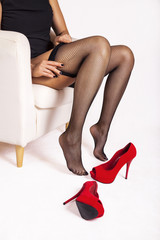 Woman puts on her fishnet stockings.