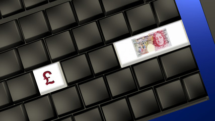 british pound banknote and sign on the laptop keyboard