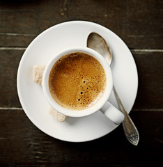 Cup of black coffee with brown sugar