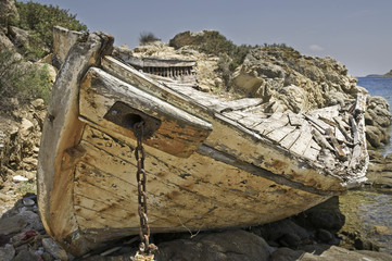 Wrecked fishing boat in the beach