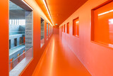 Fototapety Interior modern building with floors and orange painted passages