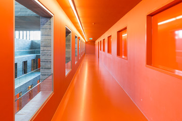Interior modern building with floors and orange painted passages
