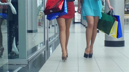 Female feet walking around the store, close up, Slow motion, two