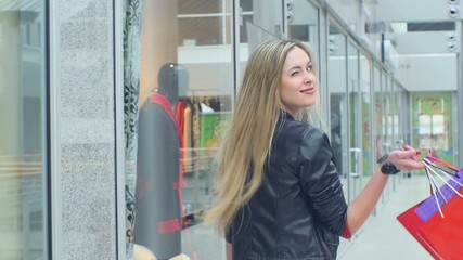 young happy beautiful blonde woman go to shopping, close up