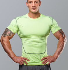 Awesome muscular man in green undershirt