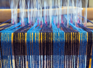 Closeup of Warp Threads at the Back of a Weaving Loom