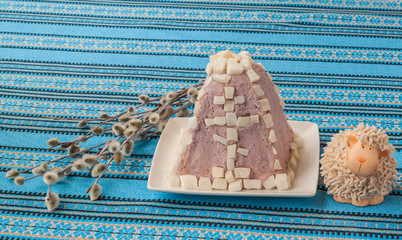 Easter dessert from cottage cheese and slices of coconut near th