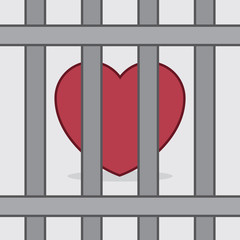 Red heart behind metal bars