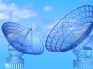 Satellite dishes on sky background