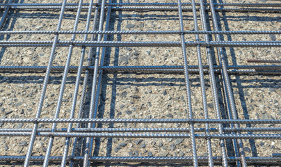 Reinforcing steel mesh, close up image of construction material.