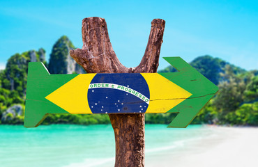 Brazil Flag wooden sign with beach background