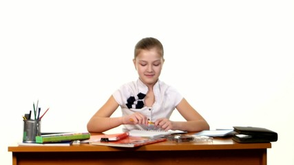 School girl doing her homework thinking about the topic of essay