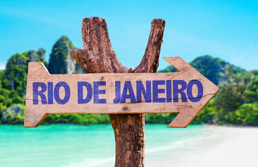 Rio de Janeiro wooden sign with beach background