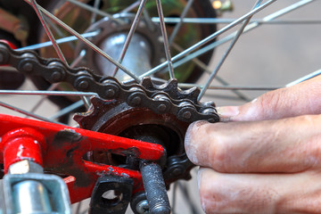 Close up working Hands Removing Bicycle Wheel