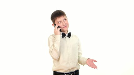 School boy talking to somebody using mobile phone, on white