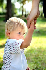 Unhappy Child hold the Parent Hand