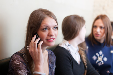 girl talking on cell phone in coffee shop