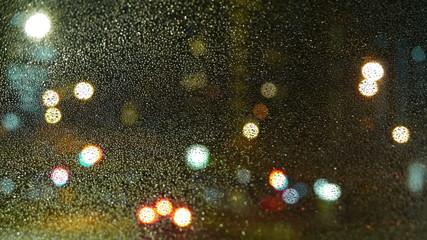 Nightlapse of out of focus illumination in rain.