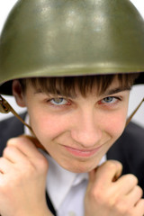 Teenager in a Military Helmet