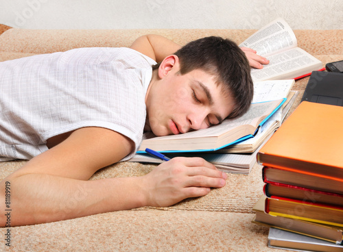 Leinwanddruck Bild Teenager sleep with the Books