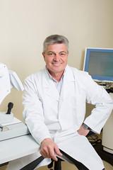 portrait of handsome elderly eye doctor