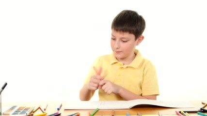 Cheerful little boy with felt-pen drawing on white background