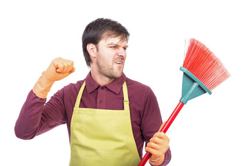 Portrait of nervous young man holding a sweep,conceptual image,
