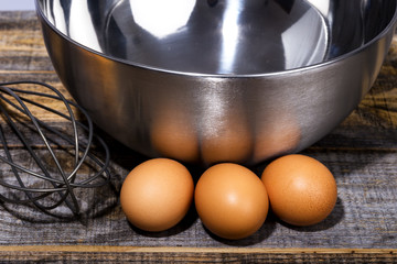 Closeup of eggs, whisk and bowl