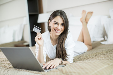 Young woman shopping from home