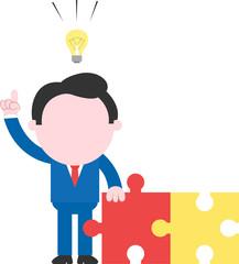 Businessman holding puzzle pieces