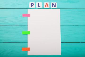 Plan list on blue wooden background