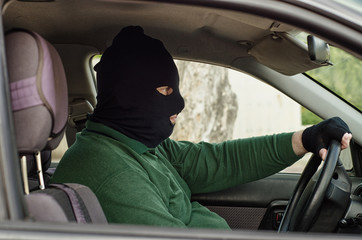 Bank robber inside a car