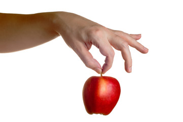 Hand holding red apple from above isolated